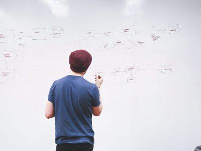 ideas-whiteboard-person-working-7369